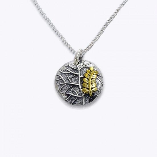 Pendant, round leaf and brass fern