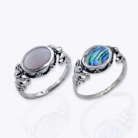 Ring, flippable oval Pinkish white and aurora borealis.