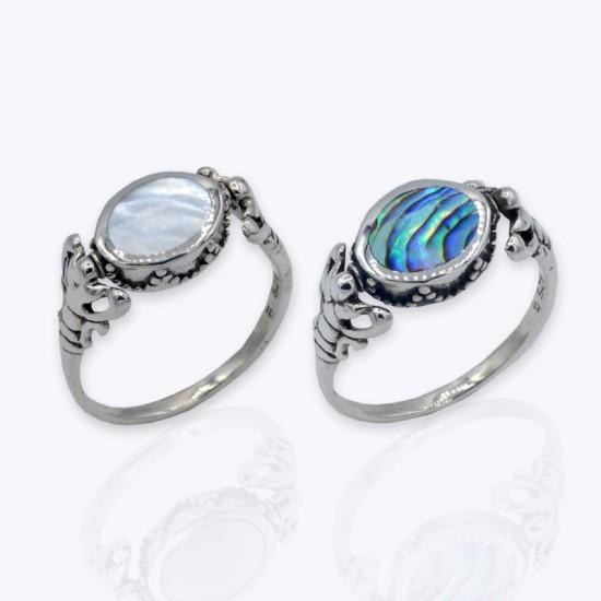 Ring, flippable oval White and aurora borealis.